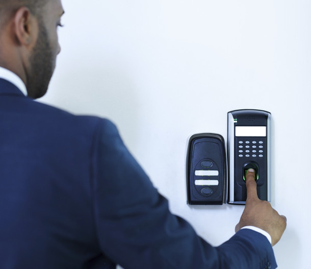 man using fingerprint access control entry system